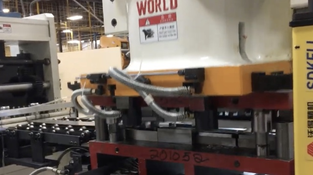 automatic press with feeder.jpg